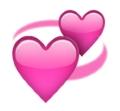 Zwei drehende pinke Herzen